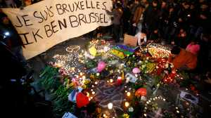 People display a solidarity banner in Brussels following bomb attacks in Brussels, Belgium