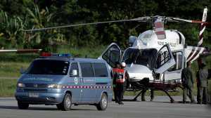 An ambulance carrying rescued schoolboys travels to a hospital from a military airport in Chiang Rai